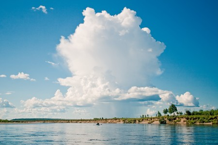 Big white cloud above Dep river, the Amur Region, Russia