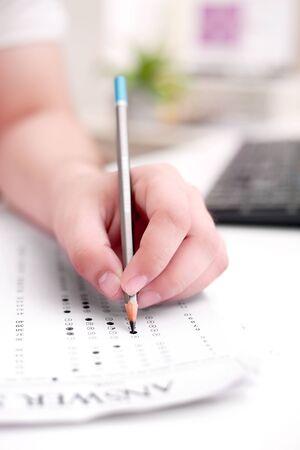 Photo pour Picture of man filling OMR sheet. - image libre de droit