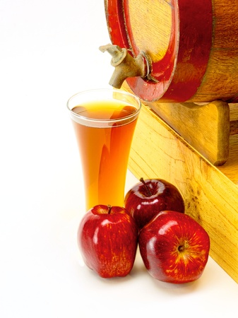 apple cider with oak barrel with red applesの写真素材