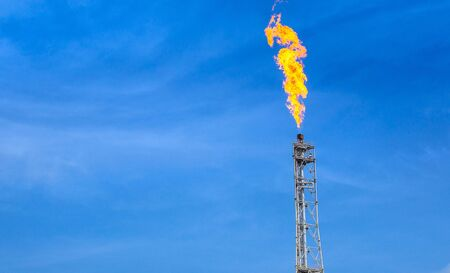 Photo for fume of fire on flare stack to burning heat gas, pollution in environment, for power and safety in petrochemical, chemical refinery or power plant in industrial zone, global warming concept - Royalty Free Image