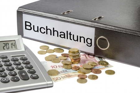 A Binder labeled wit the word Buchhaltung (German Accounting), calculator and european currency