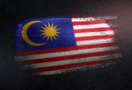 Photo pour Malaysia Flag Made of Metallic Brush Paint on Grunge Dark Wall - image libre de droit