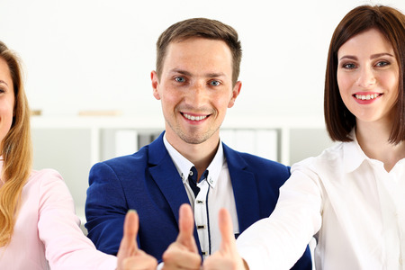 Group of people show OK or confirm with thumb up during conference portrait. High level quality product, serious offer, excellent education, mediation solution, creative advisor participation concept