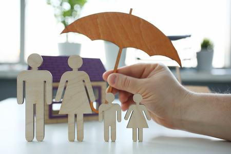 Photo pour Male insurance agent hold hands gesture shield - image libre de droit