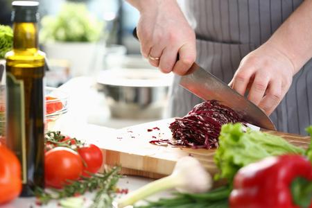 Foto für Professional Chef Hands Slicing Purple Cabbage - Lizenzfreies Bild