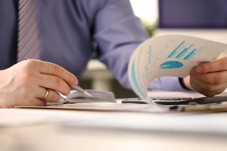 Photo pour Bookkeeper Routine Paperwork Audit Report Concept - image libre de droit