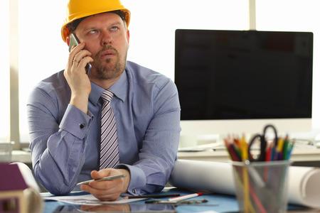 Photo pour Construction Worker Sit in Engineering Office - image libre de droit