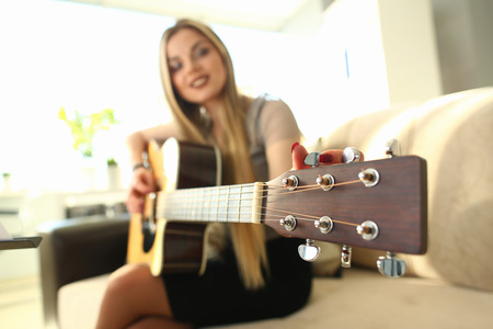 Photo for Female Guitarist Performance Music Teacher Job - Royalty Free Image