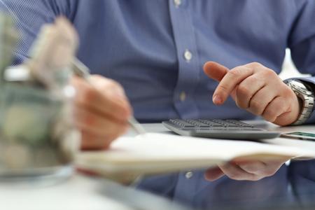 Photo pour Male hand using calculator counting financial expenses - image libre de droit