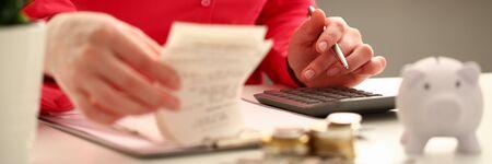 Photo pour Female hand financial inspector push key - image libre de droit