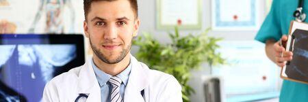 Photo pour Doctor posing in clinic cabinet - image libre de droit