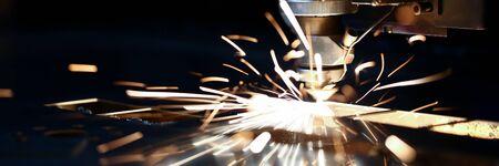 Photo pour Laser cut machine head for metal processing metallurgical plant spark background. Manufacturing finished parts for automotive production concept - image libre de droit