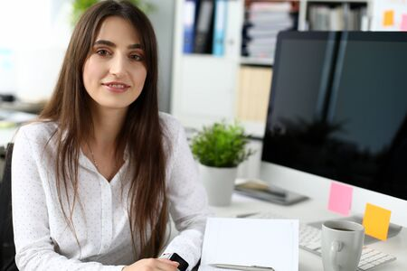 Photo for Portrait of smiling businesslady writing possible future plans. Cute businesswoman breaking off for lunch on job. Business and art design concept. Blurred background - Royalty Free Image