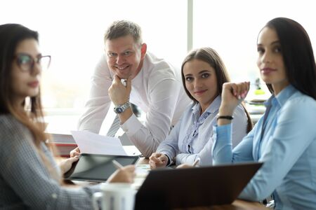 Photo pour Portrait of cheerful businesswoman and businessman discussing annual report. Perfect woman and man looking at camera with gladness. Business company and teamwork concept - image libre de droit
