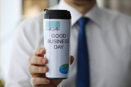 Photo for Man hold in hand thermal flask with hot beverage closeup. Good business day with coffee drink concept - Royalty Free Image