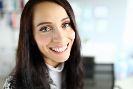 Photo for Close-up of cheerful smiling female posing on camera. Macro shot of brunette young woman with beautiful appearance. Copy space in right side. Modeling and beauty concept - Royalty Free Image