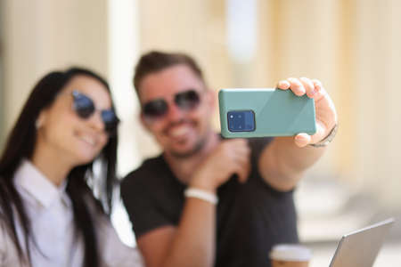 Photo for Couple take photo of themselves on phone. Man hold green phone and take photo closeup. - Royalty Free Image
