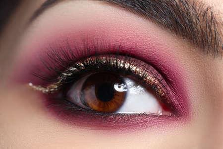 Photo pour Closeup of womans eye with beautiful makeup. Professional makeup concept - image libre de droit