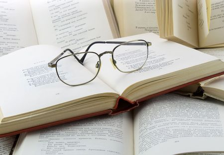 Many books and glasses on it