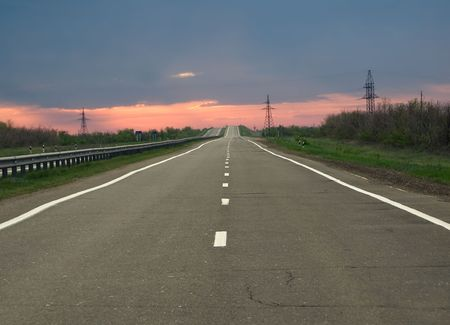 empty road to horizon at the evening