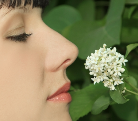 Young Woman Enjoying Smelling aroma Flowers