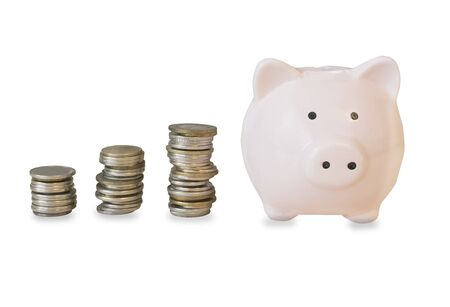 Photo pour Rose piggy bank with stack ocoins isolated over white - image libre de droit