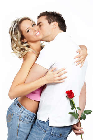 Young love couple smiling. Over white background  \r