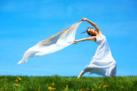 Freedom. Happy young woman running  in the field