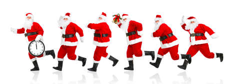 Happy running Christmas Santas. Isolated over white background