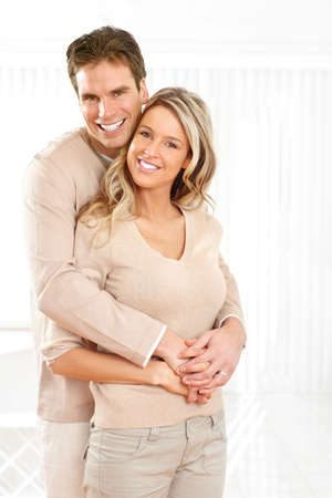 Young smiling couple at modern home