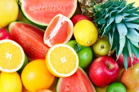 Foto de Fresh fruits: watermelon, orange, apple, peach, lemon, lime, ananas.   - Imagen libre de derechos