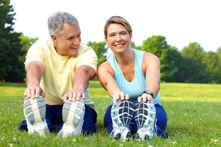 Photo pour Happy elderly seniors couple working out in park  - image libre de droit