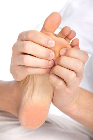 Female feet massage. Over white background