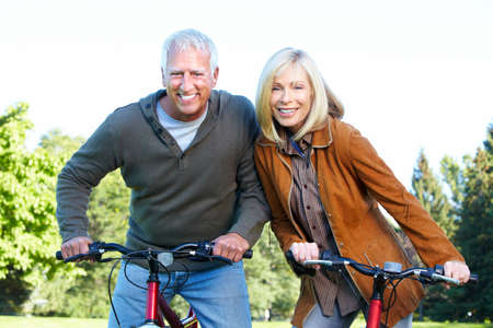 Happy senior couple cyclist