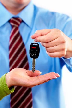 Photo pour Hand with a car key  - image libre de droit