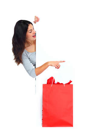 Beautiful shopping Christmas woman with bag の写真素材