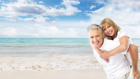 Happy senior couple on the beach の写真素材