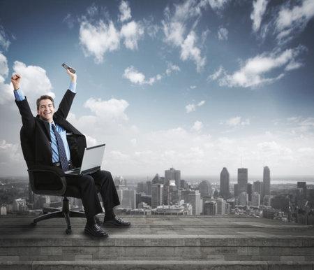 Photo pour Businessman with laptop computer  - image libre de droit
