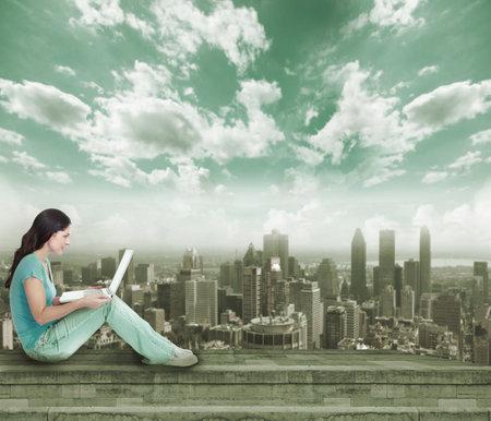 Photo pour Young woman with laptop computer  - image libre de droit