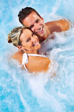 Photo pour Happy couple relaxing in hot tub. Vacation. - image libre de droit