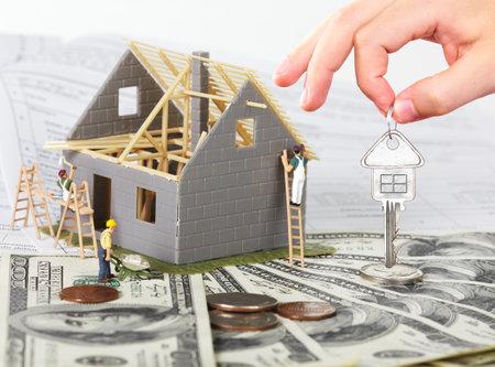 Photo pour Family house with money and key. Construction background. - image libre de droit