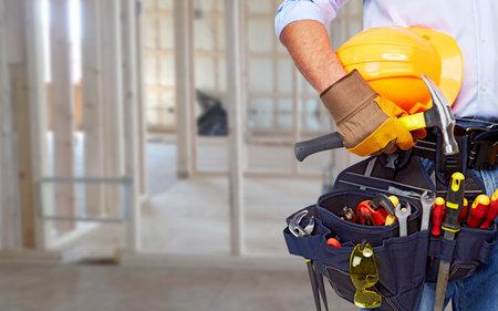 Photo pour Worker with a tool belt  - image libre de droit
