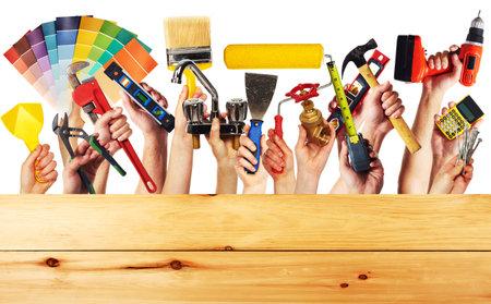 Photo pour Hands with construction tools. House renovation background. - image libre de droit