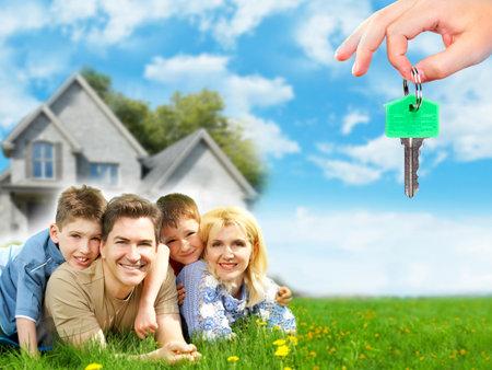 Photo pour Happy family near new home  - image libre de droit