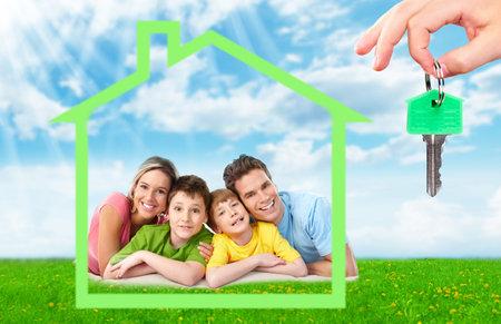 Photo pour Family near new house. - image libre de droit