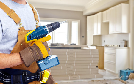 Photo pour Builder handyman with construction tools. - image libre de droit
