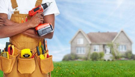 Foto de Builder handyman with construction tools. - Imagen libre de derechos