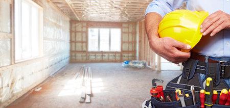 Photo pour Builder handyman with construction tools. House renovation background. - image libre de droit