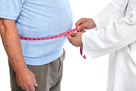 Photo pour Doctor measuring obese man waist body fat. Obesity and weight loss. - image libre de droit