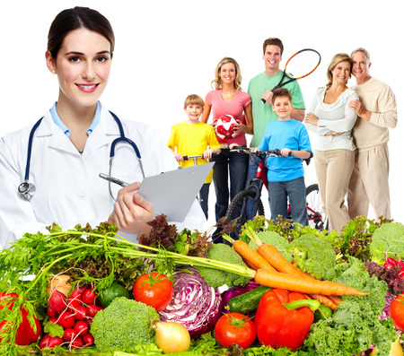 Photo pour Doctor with vegetables and family. Healthy diet and nutrition. - image libre de droit
